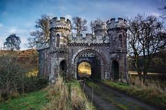 Monzie Castle: Mid Lodge (daedmike) Tags: glenturret scotland castle lodge monzie turrets arch bridge gatehouse medieval towers derelict abandoned road manor stately