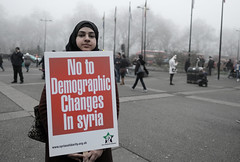 No to Demographic Changes in Syria - Tens of thousands of civilians have already been forcibly evicted from their homes by Assad's regime - A protester at Hyde Park, London - 17 December 2017 (alisdare1) Tags: fog marblearch aleppo syria assad london activists demo demonstration protest protesters sosaleppo aleppoisburning standwithaleppo savealeppo putin rally antiwar ceasefire warcrimes opposition photojournalism syrianchildren freesyria aleppocivilians activism dictatorship december2016 genocide fujixf16mm 16mmf14 fujixpro2 solidarity hijab