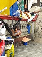 homeless family (DOLCEVITALUX) Tags: homelessfamily hammock sleeping family philippines stairs poverty reality streetpeople illegalurbandwellers