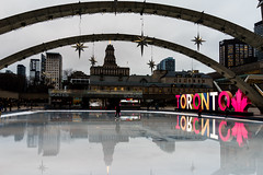 The January thaw (Howard Yang Photography) Tags: nathanphillipssquare toronto cityhall skatingrink torontosign reflections sonyrx1r 35mm