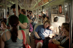 Window Seat (dtanist) Tags: new york city nyc newyorkcity bridge sleeping newyork film window brooklyn analog train subway couple kodak manhattan rangefinder olympus sp seats 100 35 zuiko dozing ektar gzuiko 35sp 42mm
