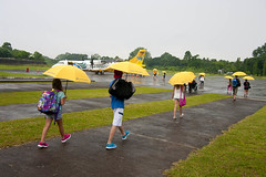 L-Q4-06-30_06h58'53''_[x-fm3023]©®©®sh (fm&hg) Tags: trip travel trees boy people plants white man motion male men wet girl grass rain station yellow female umbrella bag walking airplane person airport women gate shoes asia philippines transport cement flight young entrance terminal tourist luggage passengers traveller clear teen footwear transportation tropical baggage departure sandal vibrantcolor