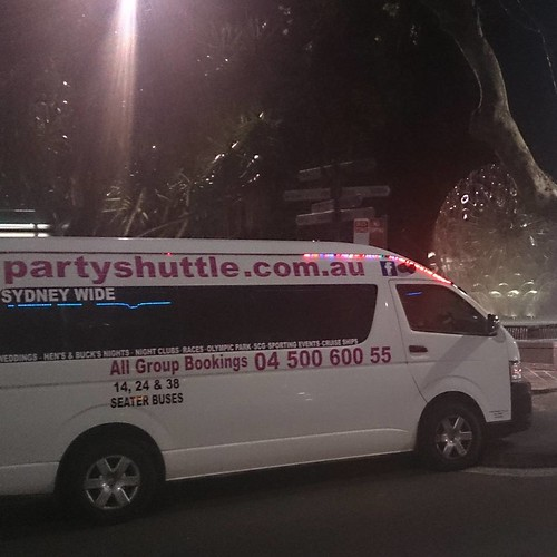 Our Party Shuttle bus cruising the night in Sydney. Can you spot where this is?