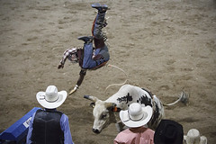Rodeo (Mathijs Buijs) Tags: usa west fall hat night america canon eos us cowboy united hats bull arena riding 7d western rodeo states wyoming cody rider nite stampede thrown tossed