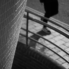 Library (Andrew Malbon) Tags: sigma sigmadp3 dp3 dp3m foveon fixedlens fixedfocallength fixed library architecture brutalism modernism modern tiles ceramic sun sunlight winterlight winter handrail street streetphotography walking walkpast paving curves depthoffield shortdepthoffield 50mmf28 50mm monochrome mono blackwhite bw