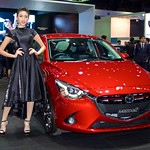 Mazda 2 with beautiful presenter at the 33rd Thailand International Motor Expo at IMPACT Challenger hall in Mueang Thong Thani, Nonthaburi thumbnail