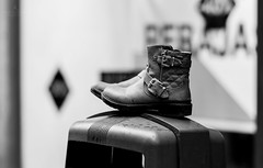 Consumerism (hector_cbs) Tags: consumerism boots shoes street discounts sales old boot shoe monochrome blackandwhite