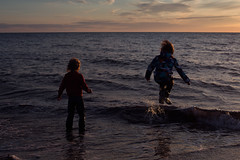 Bright summer nights (Dalla*) Tags: ocean sunset sea summer two people nature boys water kids night children outside evening iceland play bright clothed young playful wading soaked wwwdallais