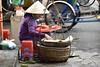 _DSC0637 (lnewman333) Tags: hoian vietnam centralvietnam sea southeastasia asia oldquarter woman vendor streetvendor hat conicalhat street food