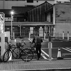 The headless cyclist, Nagoya (Paul Perton) Tags: fuji fuji35mmf14 japan nagoya xpro2 bicycle blackandwhite bw candid square street streetphotography urban