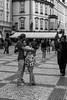 A Couple in Prague (Aaron Kaslow) Tags: streetphotography people prague nikond750 czechrepublic blackandwhite monochrome bw lovers couple man woman europe travel romance romantic hugging hugs love d750 nikon nikon50mm14 girl
