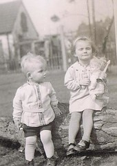 He has plans with her Doll (TrueVintage) Tags: kids children toy doll siblings kinder 1940s oldphoto foundphoto spielzeug 1944 puppe geschwister vintagephoto vintagekids