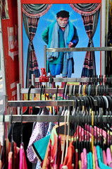 An eye on the shop (Roving I) Tags: vertical singapore beards images dresses posters littleindia contrasts racks clothingshop ilobsterit