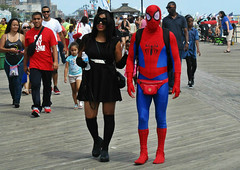 Spiderman & Catwoman strolling on the boardwalk (Robert S. Photography) Tags: costumes summer people color beach brooklyn canon comics coneyisland iso100 spiderman powershot superhero boardwalk lamps benches catwoman 2015 elph160