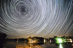 Seeleys Bay Star Trails (Matt Molloy) Tags: mattmolloy timelapse photography timestack photostack movememnt motion night sky stars trails airplanes satellites lake water reflections trees houses lights haskinspoint seeleysbay ontario canada landscape lovelife