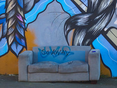 Go Away Today (Steve Taylor (Photography)) Tags: lighter settee sofa hair feathers strands goaway lumpy mural graffiti art streetart newzealand nz southisland canterbury christchurch city tresses cushion