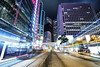 Light Show ([~Bryan~]) Tags: lighttrails lightstream night road street city urban hongkong central traffic building architecture tram bus station
