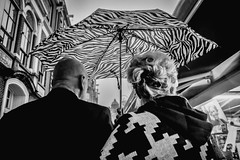 Patterns - fashion in the rain @ Amsterdam (PaulHoo) Tags: amsterdam fujifilm x70 holland netherlands 2016 rain weather city urban dutch bw monochrome blackandwhite umbrella couple pair pattern texture people candid streetcandid streetphotography fashion hair coupe fashionable style