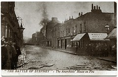 Siege of Sidney Street (1911) (The Wright Archive) Tags: seige siege sidney street battle stepney london vintage postcard valentines 1911 battleofstepney east end gunfight police army latvian immigrants revolutionaries policemen george gardstein rifles guns shot gunfire shootout social history uk twentieth century road burning building fire houses metropolitanpolice londonfirebrigade eastlondon wright archive rppc 1900s