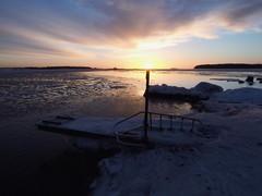 Sun balancing on a post (Jarno Nurminen) Tags: tgif balticsea winter ice sunrise helsinki finland sea pier jetty lauttasaari