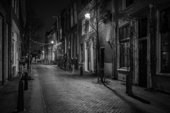 Street Spirit (McQuaide Photography) Tags: haarlem noordholland northholland netherlands nederland holland dutch europe sony a7rii ilce7rm2 alpha mirrorless 1635mm sonyzeiss zeiss variotessar fullframe mcquaidephotography lightroom adobe photoshop tripod manfrotto night nacht nightphotography stad city urban lowlight architecture outdoor outside illuminated street straat kokstraat window door entrance wideangle wideanglelens groothoek building longexposure oldstreet old oud character traditional authentic streetlight atmosphere sfeer winter emptystreet deserted empty nopeople cobblestone cobbles shadow light licht shop blackandwhite mono monochrome bw blackwhite