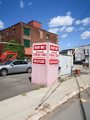 Going downtown and renting yourself a pink-painted Oriented Strand Board box. (Tim Kiser) Tags: 2016 20160829 august august2016 capitaldistrict capitalregion fullerstreet img8332 mohawkvalley newyork newyorkstate osb osbbox schenectady schenectadycounty schenectadycountynewyork schenectadynewyork stoackadestoragecubes stockadestoragecubes areacode518 car curb downtown downtownschenectady easternnewyork easternnewyorkstate electriclines exclamation exclamationmark exclamationpoint flowerpot guyanchor guywirecover guywires mislabeled mostlysunny notacube orientedstrandboard orientedstrandboardbox overheadelectriclines overheadpowerlines paved pavement phonenumber pink pinkosb pinkbox pinkorientedstrandboard pinkpaint pinkpaintedosb pinkpaintedorientedstrandboard powerlines rentme roadsideadvertisement roadsideadvertising sidewalk silvercar storagebox storagecube telephonenumber transformerbox upstatenewyork vinecoveredwall vines unitedstates