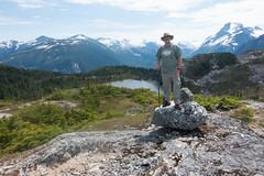 Paul atop the ridge above M Gurr Lake (Joyce Pinsker) Tags: mountains paul britishcolumbia centralcoast 2015 highway20 coastrange toppedout mgurrlake mgurrtrail nearbellacoola
