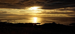 Moray Firth Golden Sunset (Tidyshow) Tags: sunset sea sun water clouds scotland seaside rocks waterfront scottish highland shore cloudscape moray firth