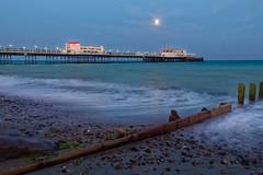 Moonlit Worthing pier (Adeypoos) Tags: summer sky moon seascape beach water clouds landscape motionblur moonlight worthingpier canoneos6d adrianpollardphotography canon2470lf4isusm