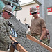 Navy Seabees lay concrete with a chute at White Beach, Okinawa, Japan.