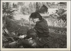 Audrey James seated on the ground putting curlers in her hair, possibly near Geraldton, Ontario / Audrey James assis sur le sol et mettant des bigoudis dans ses cheveux, peut-tre prs de Geraldton (Ontario) (BiblioArchives / LibraryArchives) Tags: voyage trip summer woman ontario canada grass car hair mirror women femme plymouth lac roadtrip voiture transcanadahighway t miroir treestump femmes bac page5 geraldton curlers cheveux gazon bigoudis libraryandarchivescanada annabrown autoroutetranscanadienne haircurls transcanadianhighway bibliothqueetarchivescanada audreyjames 2aot1954 rosemarygilliat rosemarygilliateaton laroutetranscanadienne souchefendure bouclerlescheveux helensalkeld rosemarygilliateatonfonds fondsrosemarygilliateaton august21954