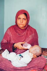 Afghan Mother with Baby (ReinierVanOorsouw) Tags: baby afghanistan female milk asia veil mother womanonly indoor afghan 1person asya afganistan azi jalalabad bottlefeeding travelphotography afghanpeople afeganisto womanportrait afganistn reisfotografie reiniervanoorsouw beyondbordersmedia dzjalalabad