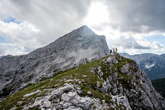 My friends at the peak of a mountain in Triglav nationalpark, Slovenia (Andersson Högholm Photography) Tags: alps alp sun light lights high hights rocks rock travel europe mountainside mountaintop summit peak mountain mountains friends green blue grey coulds canon slovenia balkan triglav landscape outdoor ridge arete rigde hill formation explore explorer