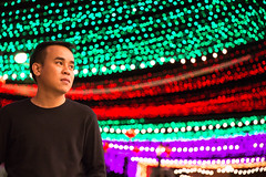 A Young Man with Multicolor Glitter Background. (baddoguy) Tags: adult adultsonly backgrounds blackcolor casualclothing citylife colorimage coloredbackground copyspace dress glitter glittering happiness horizontal journey joy loneliness looking multicolored multicoloredbackground night onemanonly oneperson oneyoungmanonly onlymen outdoors people photography standing staring tshirt thailand tourist tranquility travel traveldestinations waistup youngadult youngmen