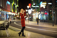 city at night III (Michael Kremsler) Tags: model shooting girl portrait fashion streetfashion dress ankleboots hat city bokeh lights pedestrians street shoppingcenter blond availablelight