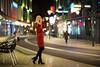 city at night III (Michael Kremsler) Tags: model shooting girl portrait fashion streetfashion dress ankleboots hat city bokeh lights pedestrians street shoppingcenter blond availablelight