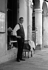 At the Riva del Vin Restaurant (AJ Photographic Art) Tags: travel travelphotography travelphotographer europe italy venice blackandwhite bw monochromatic people street streetphotography streetphotographer riva del vin restaurant rialto grand canal waiter