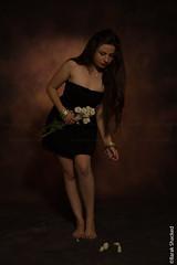 pick up the flower (barak.shacked) Tags: flowers woman flower girl whiteflower model alone bokeh fineart longhair pickup blackhair youngwoman blackdress sudio womanportrait bendingbendingwoman