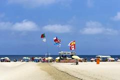 Copacabana – Nações Unidas / Copacabana - United Nations (jadc01) Tags: beach clouds céu d3200 landscape mar nature nikon1855mm people pessoas praia riodejaneiro sky streetphotography water sea flag