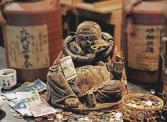 Gimme your money...and I'll give you booze! (Rekishi no Tabi) Tags: hotei money booze japan tokyo