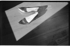 StephaniesShoesIIIcTri-X_046 (Johnny Martyr) Tags: shoes shadow rectangle trapezoid light floor woodfloor window windowlight womansshoes heels reflect reflection bright leica leitz iiic summitar rangefinder classiccamera 35mm 35mmfilm film kodaktrix kodak hc110 hc110b shapes composition angle angles withoutyou wheredidyougo lastnight themorningafter morninglight shine