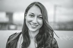 Kristina | Mannheim (sebastiankraft2) Tags: people black white schwarzweis portrait eyes augen smile lächeln mannheim 55mm face shoot retouch retouching wind hairs haare wehen city outdoor lady woman girl