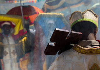 Ethiopian orthodox priests procession celebrating the colorful Timkat epiphany festival, Amhara region, Lalibela, Ethiopia