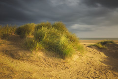 Before the Rain (Vemsteroo) Tags: light red sea seascape storm beach nature beautiful grass rain weather canon landscape coast intense sand dunes rustic norfolk dramatic coastal 5d mkiii holkham circularpolariser 1635mm beautyinnature leefilters