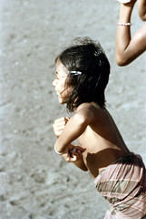 26-371 (ndpa / s. lundeen, archivist) Tags: boy bali color film 35mm indonesia coast village child 26 nick coastal southpacific watersedge local 1970s 1972 indonesian villager balinese dewolf oceania pacificislands nickdewolf photographbynickdewolf reel26