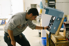 A Pika electrical engineer working on the Pika B801 Battery Charge Controller