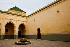 A courtyard fit for Remembrance (AurangzebH) Tags: light art yellow architecture shrine shadows angles mosque morocco mausoleum walls ismail islamic meknes moulay