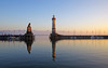 Sunset at the lighthouse (pentars) Tags: lighthouse sunset landscape scenery view beautiful lake beacon reflection evening autumn lindau bodensee mountains water blue sun pentax k5ii sigma 1020 f35 town light wide angle
