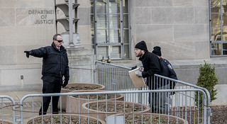 A Protester Interacts with a Police Officer During an Anti-Tear-Gas Demonstration Outside the U.S. Department of Justice