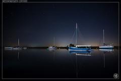 Le calme avant la tempête ? (stofmania) Tags: christopheaubin stofmania bateaux boats harbour night nuit port reflects reflets stars étoiles